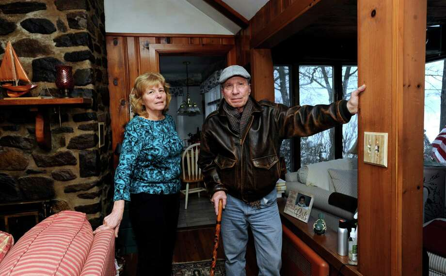 Some Danbury homeowners, particularly those living by Candlewood Lake, are upset about a large increase in their taxes. Joanne, 70, and Michael Calandrino, 68, who live on Lake Road in Danbury, Conn., are among those upset Monday, Feb. 3, 2014. Photo: Carol Kaliff / The News-Times