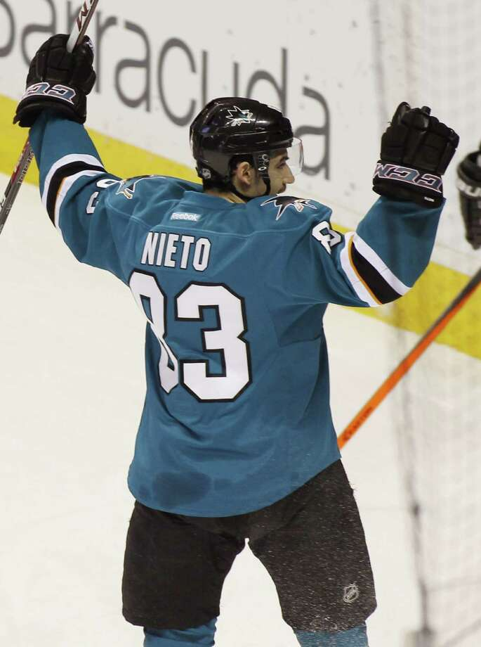 San Jose Sharks' Matt Nieto raises his hands after scoring against the Philadelphia Flyers during the first period of an NHL hockey game, Monday, Feb. 3, 2014, in San Jose, Calif. Photo: George Nikitin, AP / FR57659 AP
