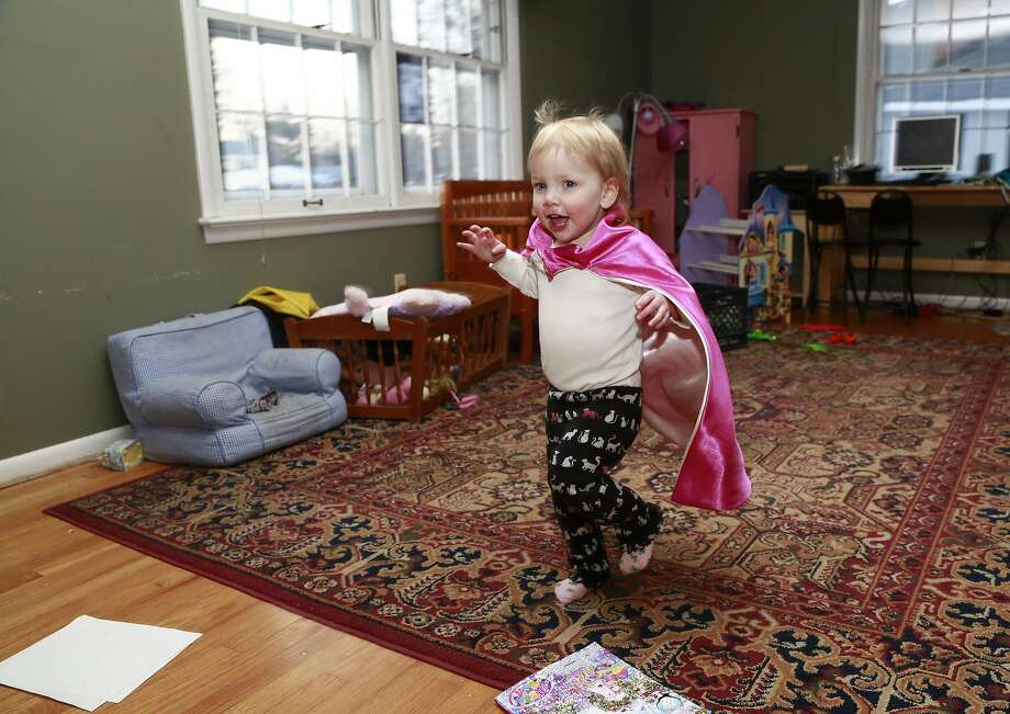 Felicity Beck-Kehoe runs wearing a cape through the family home of her parents Mike Beck and Joanne Kehoe as the family tries to combat cabin fever, Monday, Feb. 3, 2014, in Indianapolis. (AP Photo/R Brent Smith) Photo: R Brent Smith, Associated Press