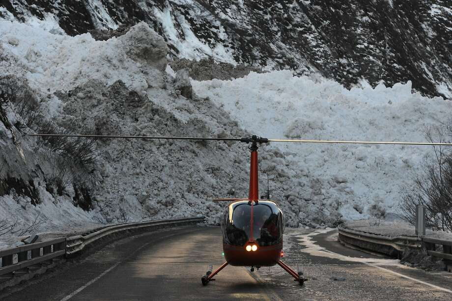 The Richardson Highway, in Alaska, near Mile 16 is still buried under debris from a massive avalanche in Snowslide Gulch near Keystone Canyon and the Lowe River as road crews wait for the flooding to recede on Wednesday, Jan. 29, 2014. (Bill Roth/Anchorage Daily News/MCT) Photo: Bill Roth, McClatchy-Tribune News Service