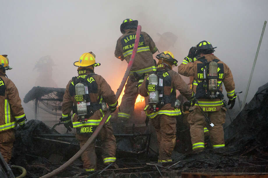 The two-alarm blaze broke out about 5:20 a.m. Tuesday at commercial   businesses on Aldine Bender near the Hardy Toll Road, according to   Harris County fire officials. Photo: Cody Duty, Houston Chronicle / © 2014 Houston Chronicle