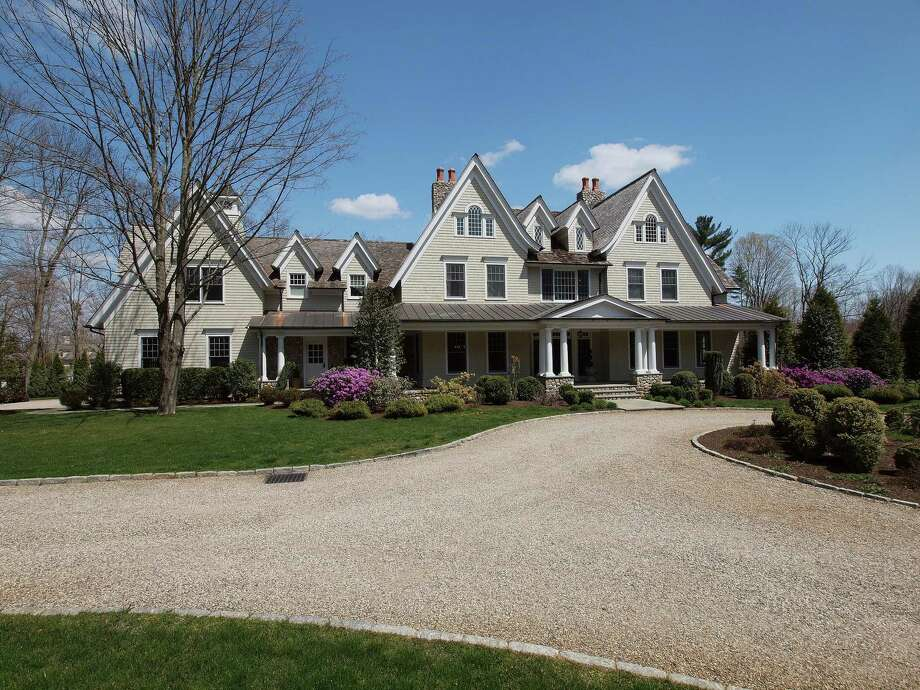 The Colonial at 1083 Smith Ridge Road in New Canaan, behind two electronic gates that provide safety and privacy from the main road, is on the market for $5,995,000. Photo: Contributed Photo, Contributed / New Canaan News Contributed