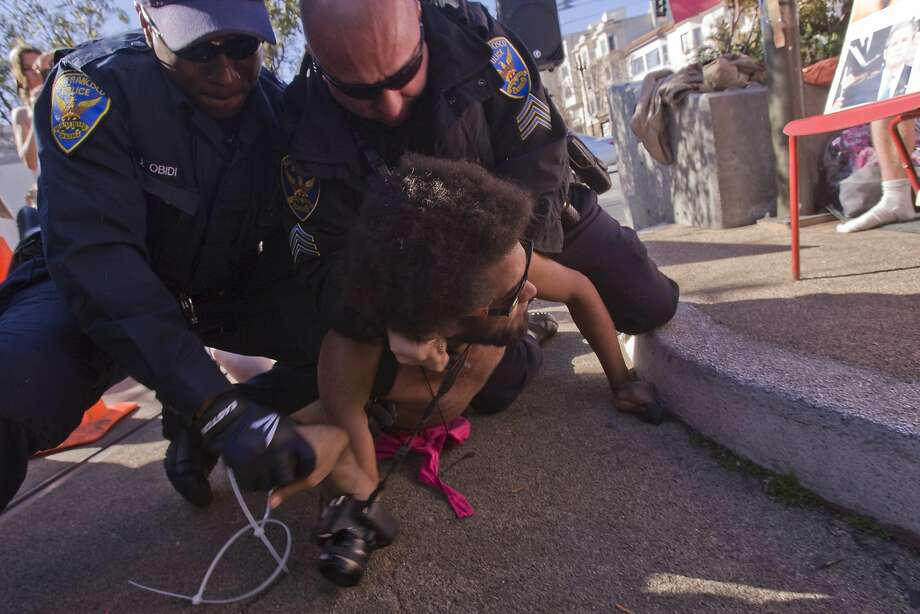 Protester arrested during demonstra- tion against the city's ban on nudity at Castro and Market streets last week. Photo: Andre Zandona, The Chronicle