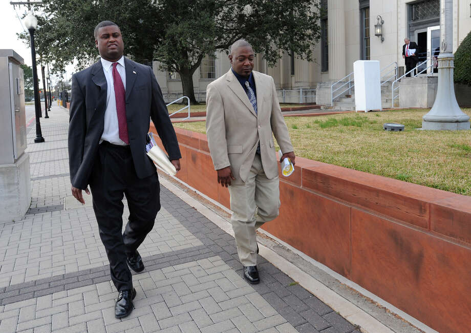 From left, Langston Adams and Derreck Newman exit the Federal Courthouse in Beaumont on Monday. Newman successfully sued Todd Burke for violating his civil rights in a 2007 patrol stop.