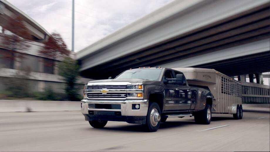 The new 2015 Chevrolet Silverado HD made a bullish first impression in its new commercial, will air during the Super Bowl XLVIII broadcast on FOX on Sunday, Feb. 2, 2014. The 2015 Silverado HD's first TV ad, Romance, is a charming story about a man, his truck and a new bachelor in town. It follows a handsome cattle rancher as he transports his stud bull to an exciting, romantic rendezvous across town in the new Silverado HD, Chevrolet's strongest and most advanced heavy-duty pickup ever. (General Motors/MCT) Photo: General Motors, McClatchy-Tribune News Service
