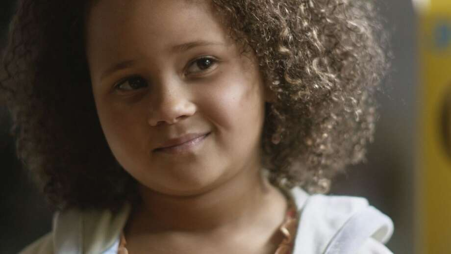 "This undated frame grab provided by General Mills shows the company's 2014 Super Bowl for Cheerios entitled ""Gracie."" Cheerios brought back its famous interracial family in a spot that shows a father using Cheerios to tell his daughter she's going to have a baby brother. The ad airs during the first unscheduled time-out of the game.  (AP Photo/General Mills) Photo: Associated Press/General Mills"