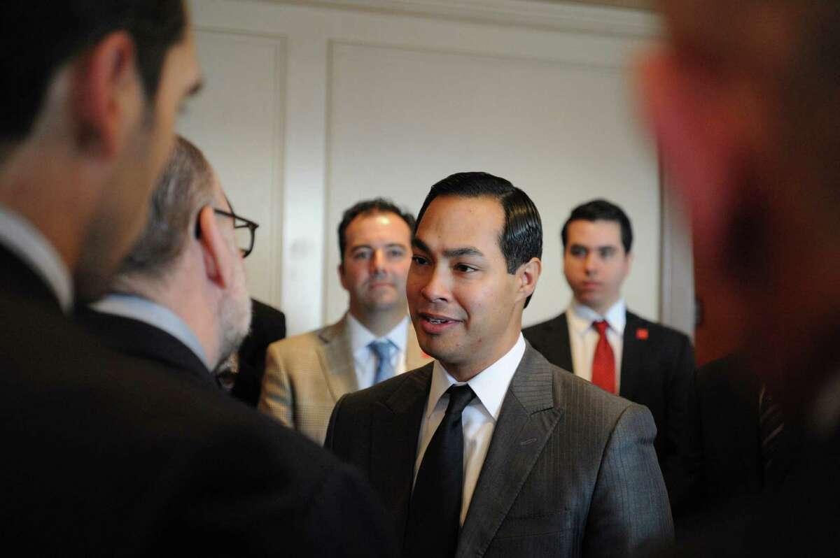Mayor Julian Castro, middle, speaks with Gustavo Guzman, president of TV Azteca America, during an Asociacion de Empresarios Mexicanos breakfast at the Plaza Club in downtown San Antonio on Wednesday, Jan. 29, 2014.