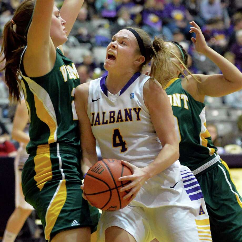 UAlbany's #4 Sarah Royals, center, goes to the basket while being double teamed by Vermont defense in the Big Purple Growl game Saturday Feb. 1, 2014, in Albany, NY.   (John Carl D'Annibale / Times Union) Photo: John Carl D'Annibale, Albany Times Union / 00025543A