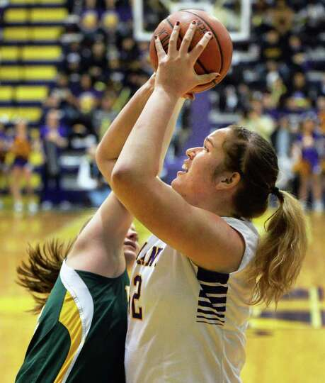UAlbany's #32 Megan Craig gets past Vermont 's #14 Niki Taylor, left, for the shot during the Big Pu