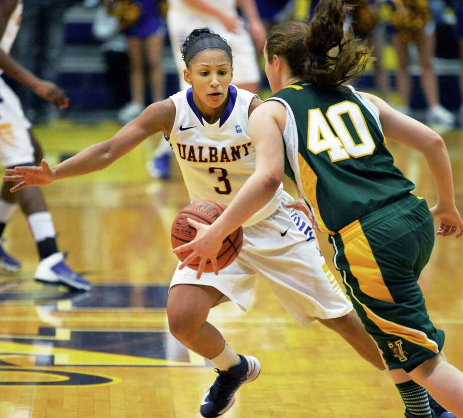 UAlbany's #3 Margarita Rosarion, left, covers Vermont's #40 Jordan Eislaer in the Big Purple Growl game Saturday Feb. 1, 2014, in Albany, NY.   (John Carl D'Annibale / Times Union) Photo: John Carl D'Annibale, Albany Times Union / 00025543A