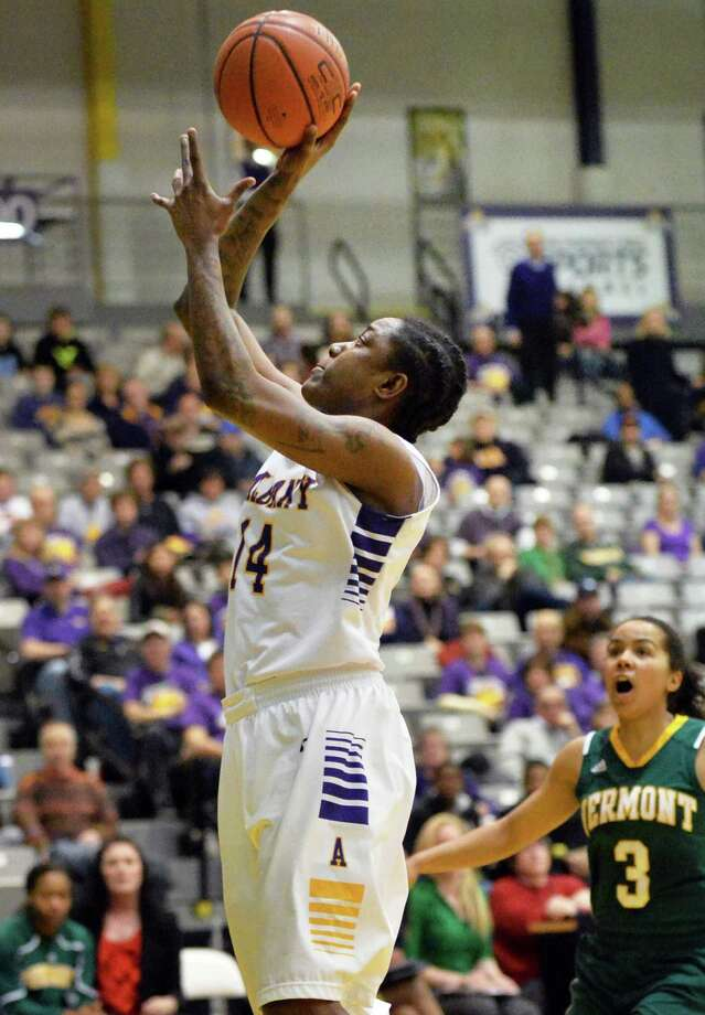 UAlbany's #14 Tammy Phillip gets off a shot against Vermont in the Big Purple Growl game Saturday Feb. 1, 2014, in Albany, NY.   (John Carl D'Annibale / Times Union) Photo: John Carl D'Annibale, Albany Times Union / 00025543A