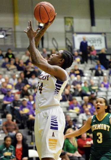 UAlbany's #14 Tammy Phillip gets off a shot against Vermont in the Big Purple Growl game Saturday Fe