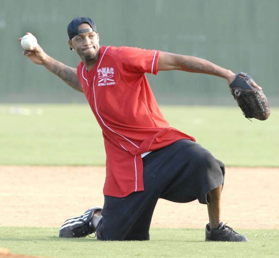 Tracy McGrady  The 13-year NBA veteran has always had an interest in playing baseball. 'T-Mac' has been working with Roger Clemens in hopes of beginning a career in the minor leagues as a pitcher. Photo: Tim Johnson, For The Chronicle