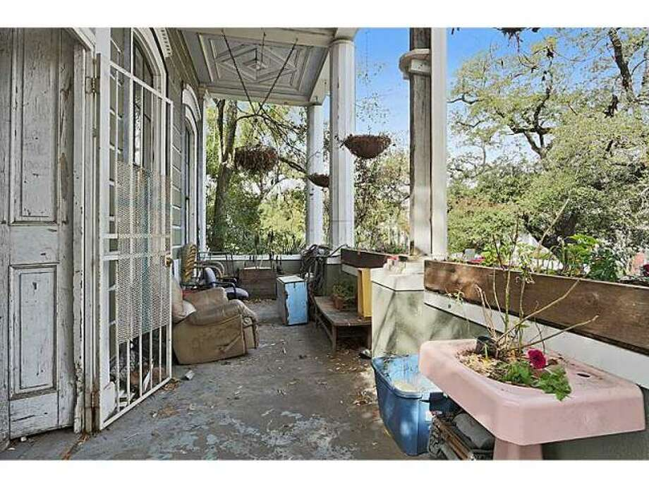 Porch, a must have in the Treme. Photo via MLS/Gardener Realtors.