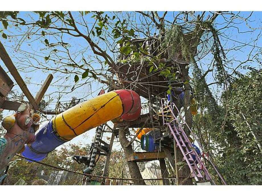 Tree house with slide. Photo via MLS/Gardener Realtors.