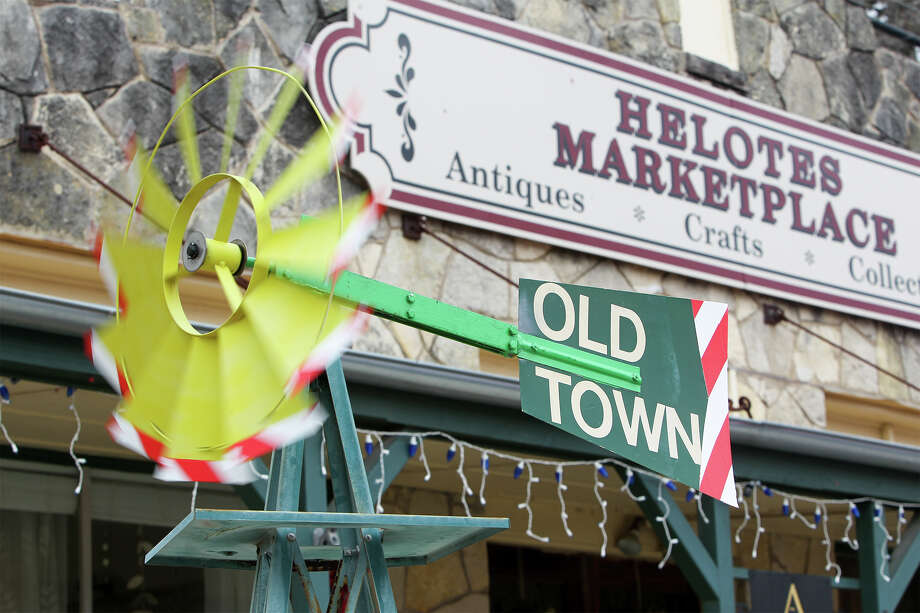 "An ""Old Town"" windmill blows in front of the Helotes Marketplace in Old Town Helotes Photo: MARVIN PFEIFFER, Marvin Pfeiffer / EN Communities / EN Communities 2014"