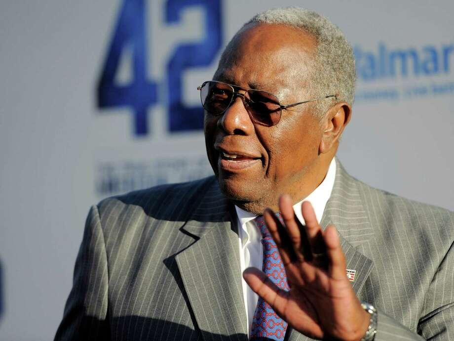 """Baseball great Hank Aaron waves to photographers at the Los Angeles premiere of """"42"""" at the TCL Chinese Theater on Tuesday, April 9, 2013 in Los Angeles. (Photo by Chris Pizzello/Invision/AP) Photo: Chris Pizzello / Invision"""