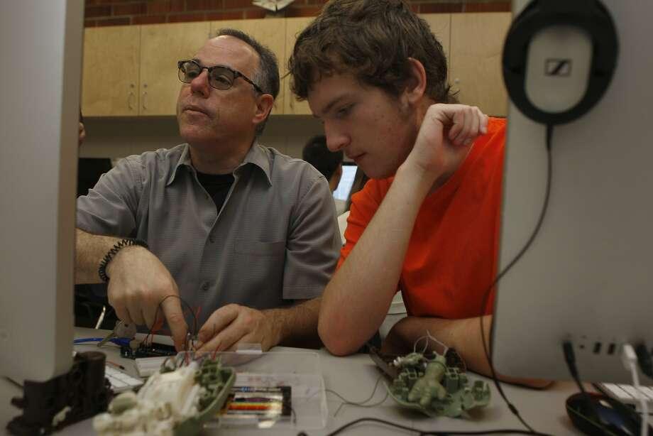 Teacher Glenn Corey (left) and student Calun Bliss work on a project in Corey's lab at Novato High School. Photo: Liz Hafalia, The Chronicle