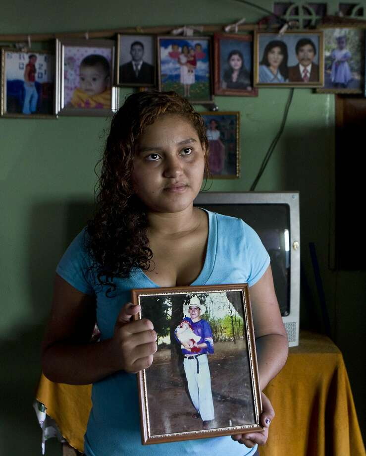 Alvarenga's daughter, Fatima, holds a photo of herself as a baby with her father. Photo: Esteban Felix, Associated Press