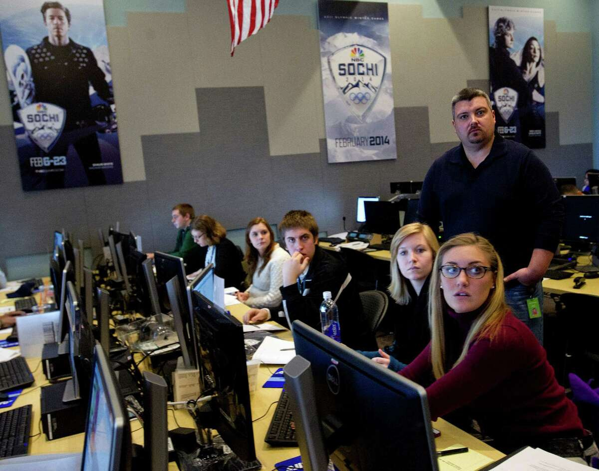 Interns sit in the Highlights Factory at NBC Sports in Stamford, Conn., on Tuesday, February 4, 2014, as they are trained to choose highlights of sports events when the 2014 Olympics in Sochi, Russia, begin.