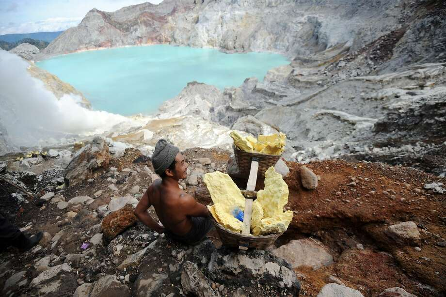 Back-breaking work: A miner rests while carrying blocks of sulphur from Ijen crater in Banyuwangi East Java. 