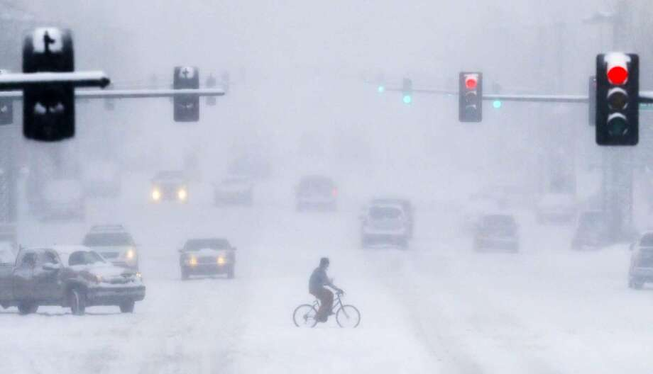 This was the scene Tuesday morning in downtown Wichita, Kan. Great day for a bicycle ride! Photo: Travis Heying, Associated Press