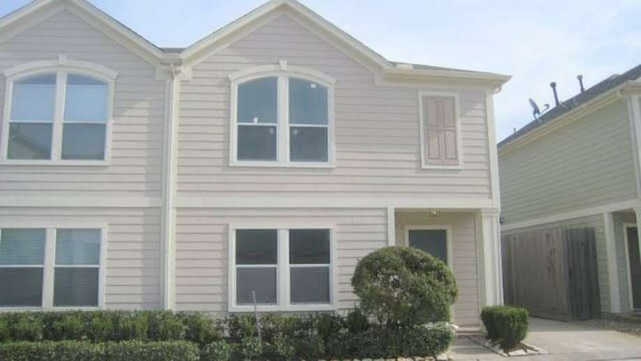 2623 Woodridge Cove: This 2004 townhome has 2 bedrooms, 1.5 bathrooms, 1,299 square feet, and is listed for $120,000.