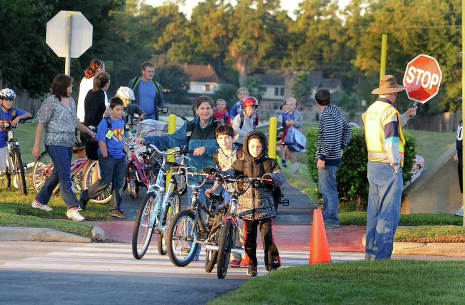 Some residents in the neighborhoods around T.C. Jester Boulevard are against the replacing of stop signs with traffic signals, saying it will be more dangerous for schoolchildren, families. Photo: David Hopper, Freelance / freelance