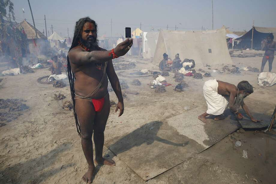 Pre-holy dip portrait:A sadhu, or Hindu holy man, takes a selfie at Sangam, the confluence of the Ganges and Yamuna rivers in Allahabad, India. Photo: Rajesh Kumar Singh, Associated Press