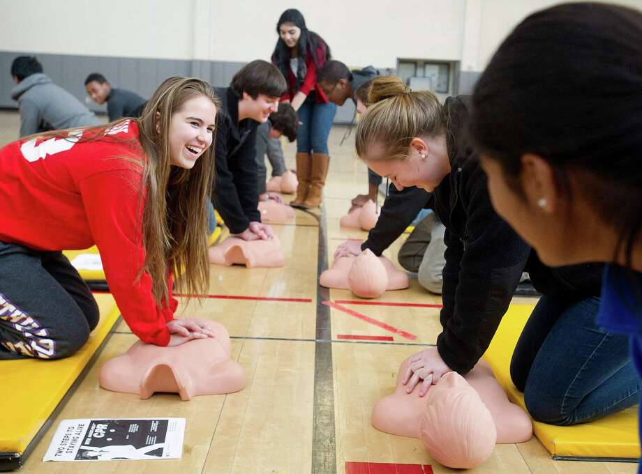 Alex Bergman, left, performs compressions as AITE students learn hands-only CPR on Tuesday, February 4, 2014, during a non-certification awareness class in honor of National American Heart Month. Photo: Lindsay Perry / Stamford Advocate