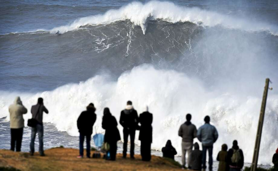 Like Mavericks but bigger: Andrew Cotton of surfs a wave at Praia do Norte in Nazare, Portugal. The largest wave ever ridden was at Nazare in 2011, according to Guinness World Records. Photo: Miguel Barreira, Associated Press