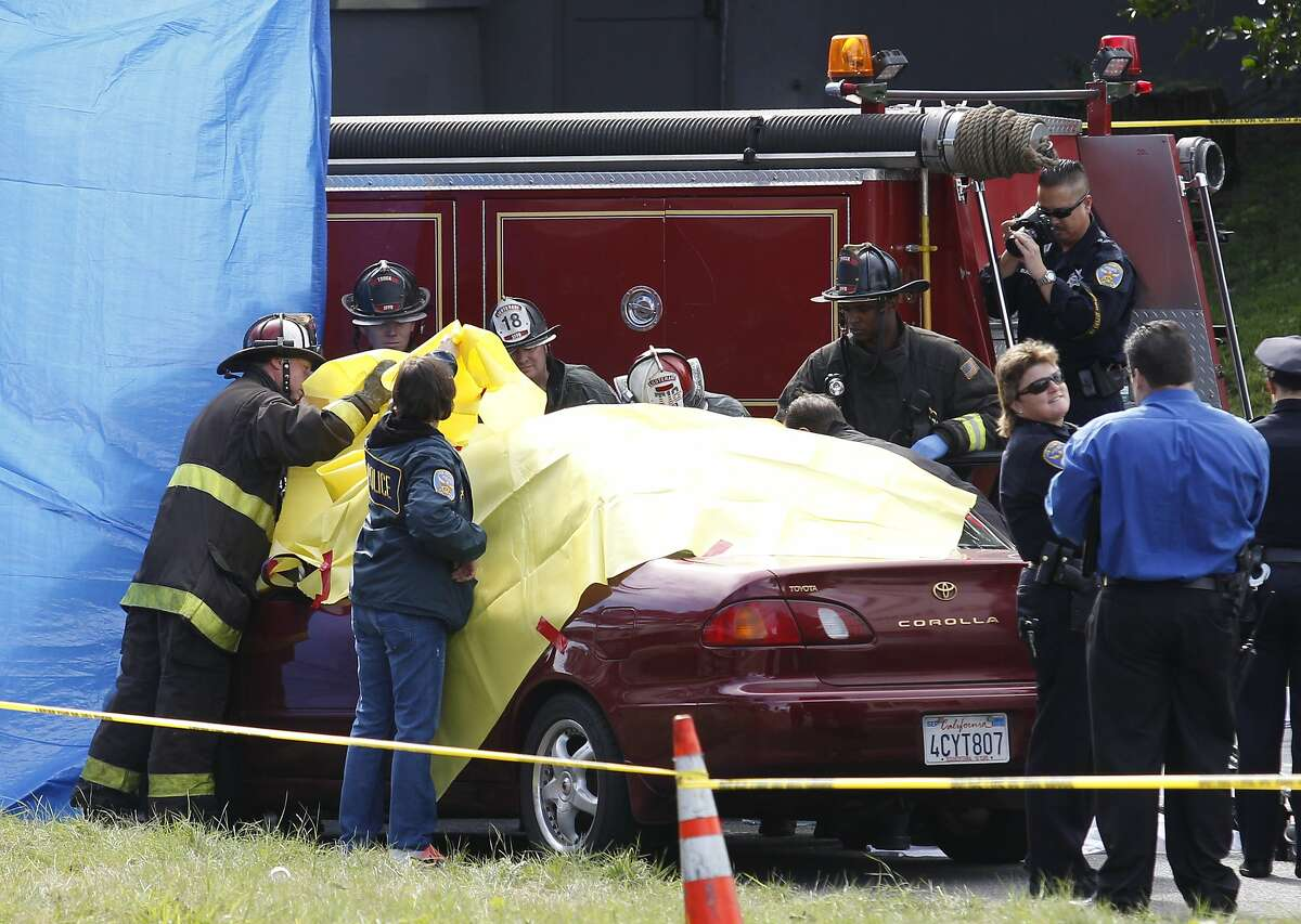 San Francisco firefighters and police officers attend to an accident scene involving a pedestrian death at the intersection of Yorba Street and Sunset Boulevard on Tuesday, February 4, 2014 in San Francisco, Calif.