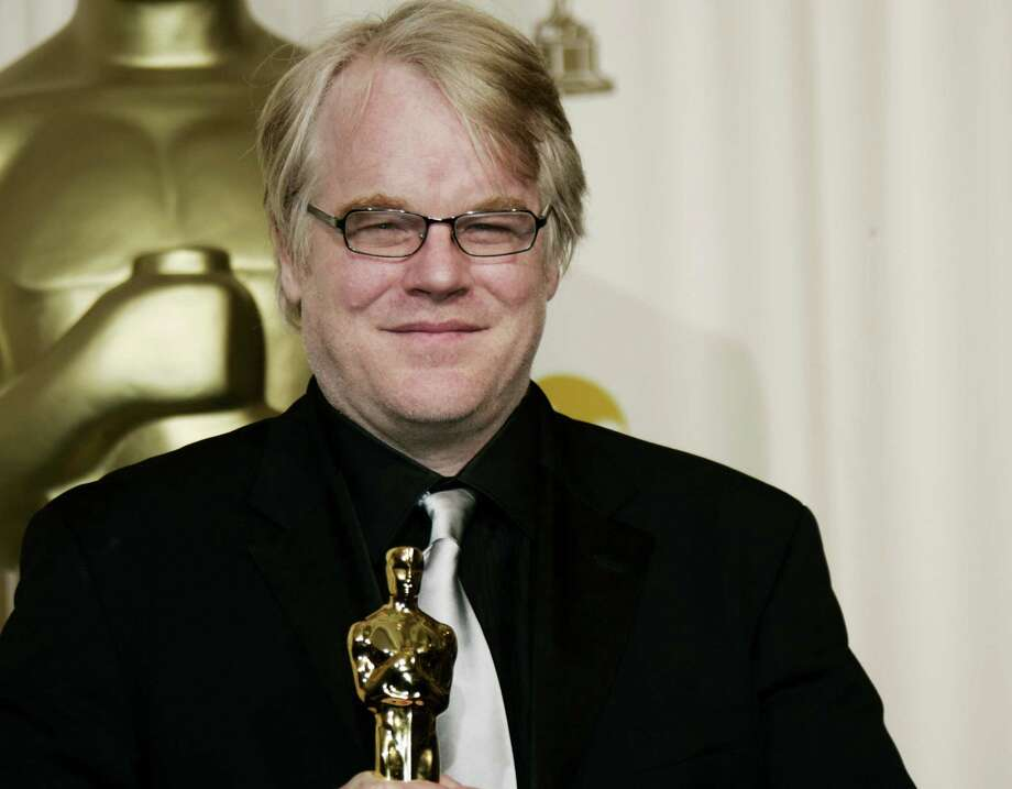 "Philip Seymour Hoffman poses with the Oscar he won for best actor for his work in ""Capote."" He was found dead Sunday from an apparent heroin overdose. Photo: Associated Press File Photo / AP"