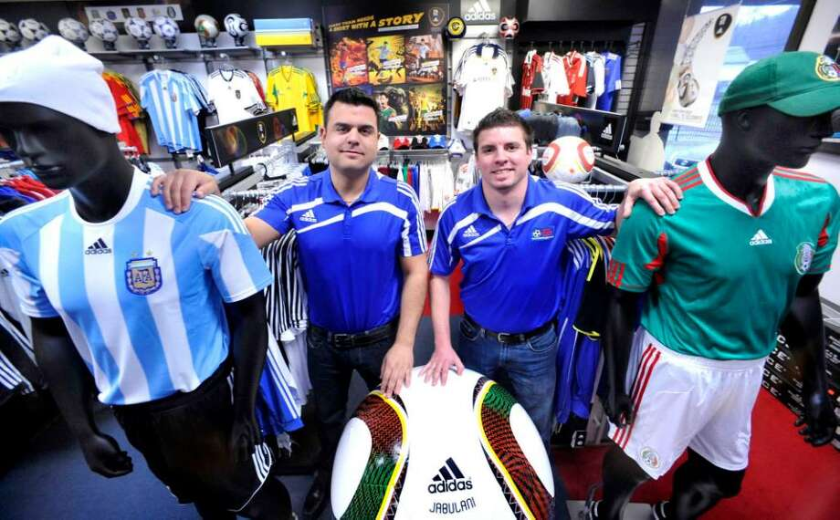 Gus Avalos, left, and Paul Melitsanopoulos, in Soccer & Rugby Imports, a Ridgefield business, on Monday, Jan.25,2010. Photo: Michael Duffy / The News-Times