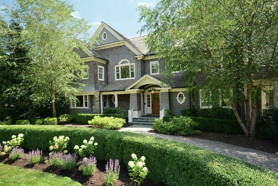 Data released by the New Canaan Assessor's Office in January shows that the value of homes over $3 million, like the one shown above, decreased in 2013, bringing the overall real property value in New Canaan down by 2.8 percent. Photo: Contributed Photo, Contributed / New Canaan News Contributed