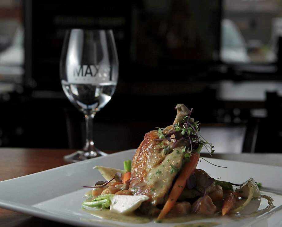 The new Max's Wine Dive menu features Chicken & Sriracha Dumplings: half a braised chicken, velouté, baby carrots and turnips. Photo: James Nielsen, Staff / © 2013  Houston Chronicle