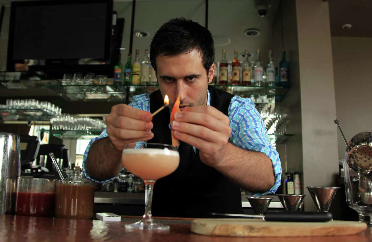 Bar manager Nick Barton makes a Simpatico gin cocktail. Trenza boasts an ambitious cocktail program and well-matched wines.