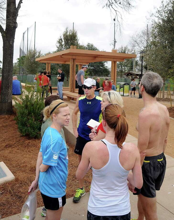 Runner's High club members Sherry McShan, clockwise from left, Gary Mulvihill, Sherri Richey, Tim Nolan and Victoria Webster check out the new stretching deck at Memorial Park. Photo: Dave Rossman, Freelance / © 2013 Dave Rossman