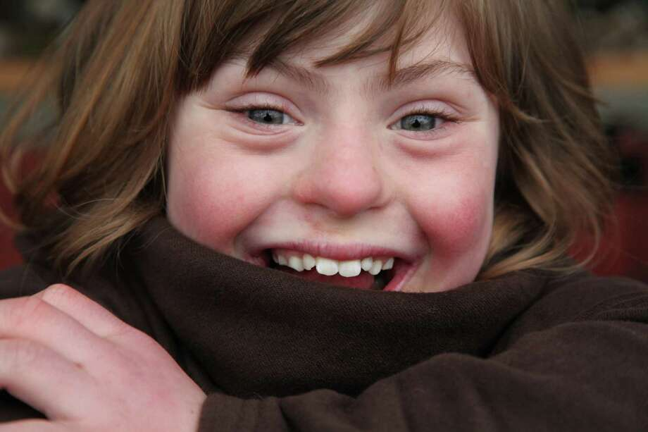 "Rick Guidotti's ""Positive Exposure"" exhibit includes a joyful portrait of Grace, who has Down syndrome. Photo: Rick Guidotti"