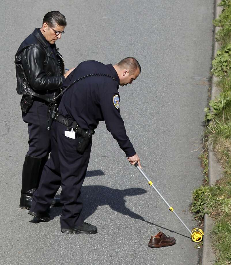 Another pedestrian death: San Francisco police investigate a fatality Tuesday on Sunset Boulevard in the Parkside area. The victim was in or near a crosswalk in an uncontrolled intersection when he was hit. Photo: Beck Diefenbach, Special To The Chronicle