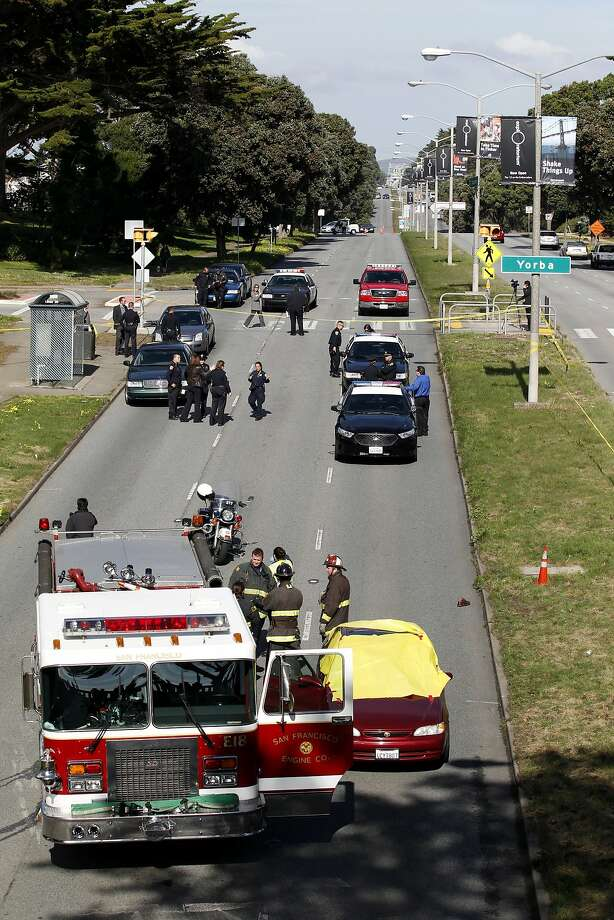 San Francisco firefighters and police officers attend to an accident scene involving a pedestrian death at the intersection of Yorba Street and Sunset Boulevard on Tuesday, February 4, 2014 in San Francisco, Calif. Photo: Beck Diefenbach, Special To The Chronicle