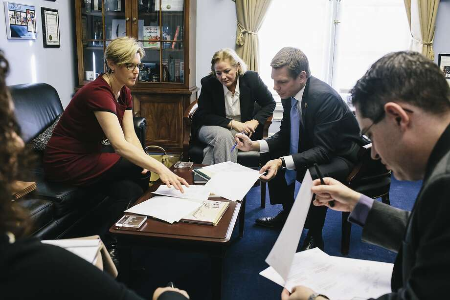 Teresa Drenick, an Alameda County assistant district attorney (left), and District Attorney Nancy O'Malley meet with Rep. Eric Swalwell, D-Dublin, at his office in Washington to discuss the backlog in untested rape kits. Photo: Greg Kahn, Special To The Chronicle