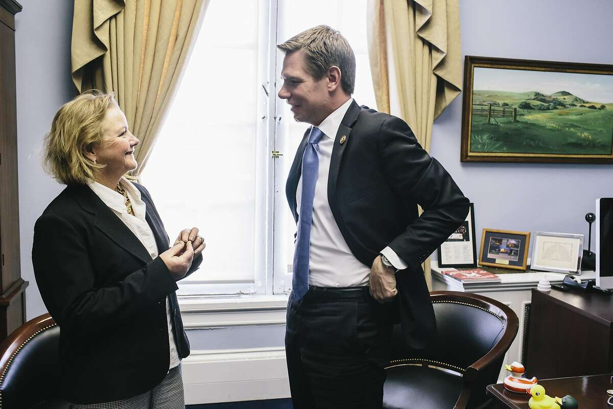 Congressman Eric Swalwell, right, talks with Alameda County District Attorney Nancy O'Malley, left, about how to end the backlog in untested rape kits during a meeting at Congressman Swalwell's office on Feb. 4, 2014 in the Cannon Building in Washington, D.C.