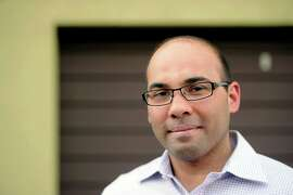 Up and coming Oakland A's baseball executive Farhan Zaidi poses for a photo on December 17, 2013 in the Lower Elmwood neighborhood of Berkeley, Calif.