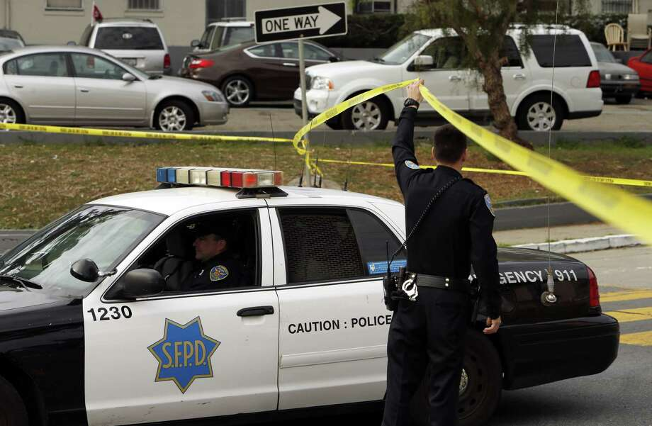 San Francisco police officers leave the scene of a search for a suspect in an officer-involved shooting in February 2014. Photo: Carlos Avila Gonzalez / The Chronicle 2014 / ONLINE_YES