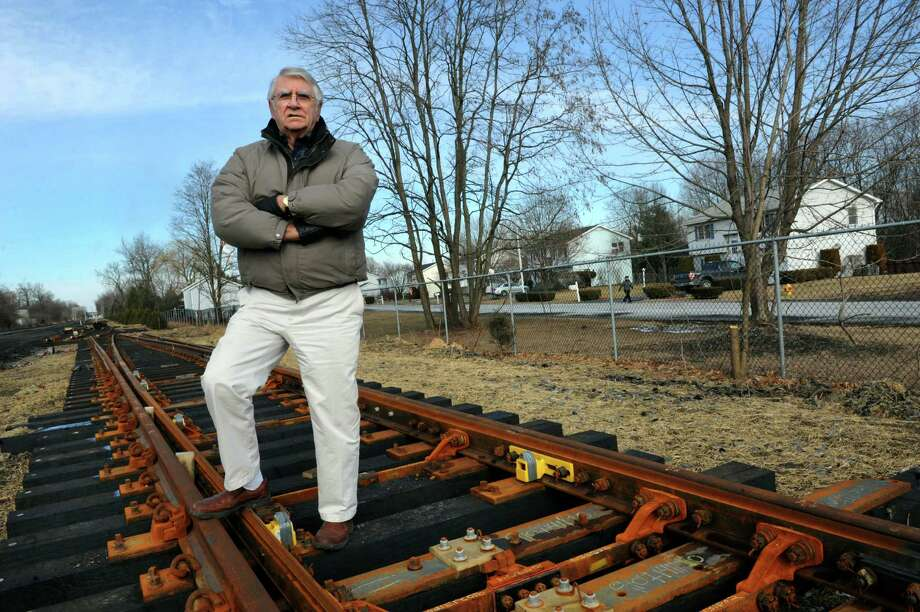 Mayor John Bruno stands on tracks that will be installed for a second railroad line near Magnolia Circle on Tuesday, Feb. 4, 2014, in Ravena, N.Y. Residents are raising concerns about a potential increase in crude oil rail transportation through the village. (Cindy Schultz / Times Union) Photo: Cindy Schultz / 00025624A