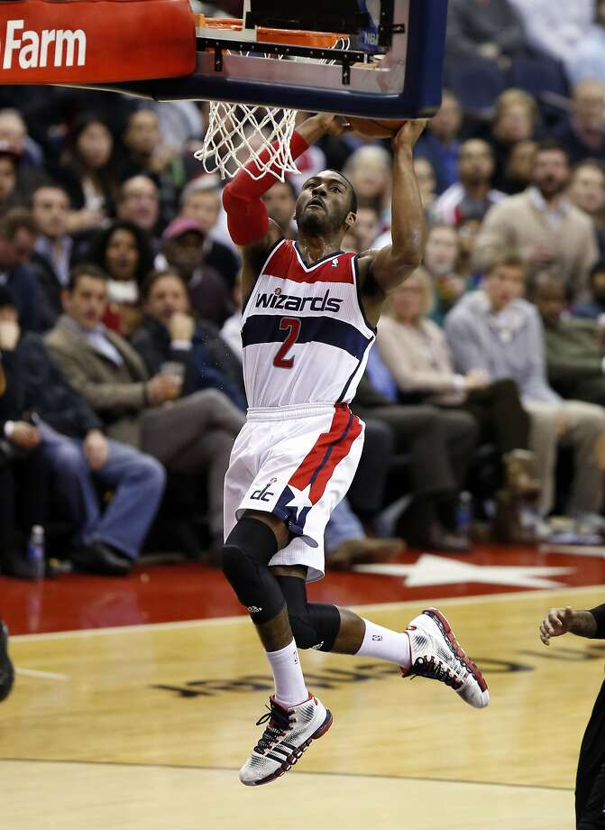 Washington Wizards guard John Wall (2) dunks the ball in the second half of an NBA basketball game against the Portland Trail Blazers, Monday, Feb. 3, 2014, in Washington. The Wizards won 100-90. (AP Photo/Alex Brandon) Photo: Alex Brandon, Associated Press