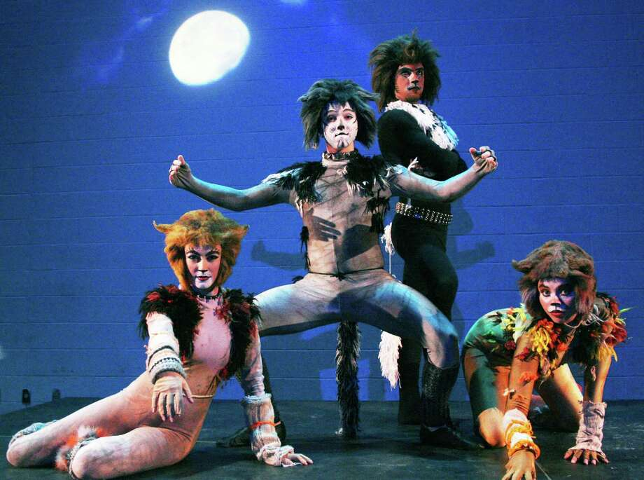 'Cats'  Students and faculty at New Milford High School are busy preparing this yearâÄôs all-school musical production of âÄúCats.âÄù Above, from left to right, Jackie Mercer, Tommy Ovitt, Andrew McGuire and Becca Myhill pose in their costumes. The original 1982 Broadway production ran for 18 years, featuring music by Andrew Lloyd Webber and choreography by Gillian Lynne. The lyrics are based on T.S. EliotâÄôs âÄúOld PossumâÄôs Book of Practical Cats.âÄù Evening performances will be presented March 21, 22, 28 and 29 at 7 p.m. in the NMHS theater. Matinees will be offered March 23 at 3 p.m. and March 29 at 2 p.m. All seating at $10 per person is reserved.Tickets can be purchased by visiting the high school box office Mondays through Fridays from 2:15 to 4 p.m. and Mondays through Thursdays from 6:30 to 8:30 p.m. Tickets are also available by calling 860-350-6647 ext. 1552.  Courtesy of New Milford High School Photo: Contributed Photo / The News-Times Contributed