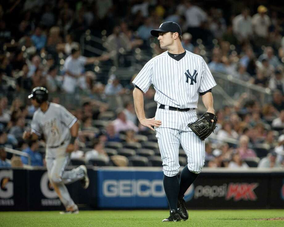 New York Yankees relief pitcher David Robertson (30) reacts after a 3 run home run by Chicago White Sox left fielder Dayan Viciedo (24) in the 9th inning of the Yankees 4-3 loss. New York Yankees against the Chicago White Sox at Yankee Stadium. (Ron Antonelli/ New York Daily News) Photo: Ron Antonelli / New York Daily News