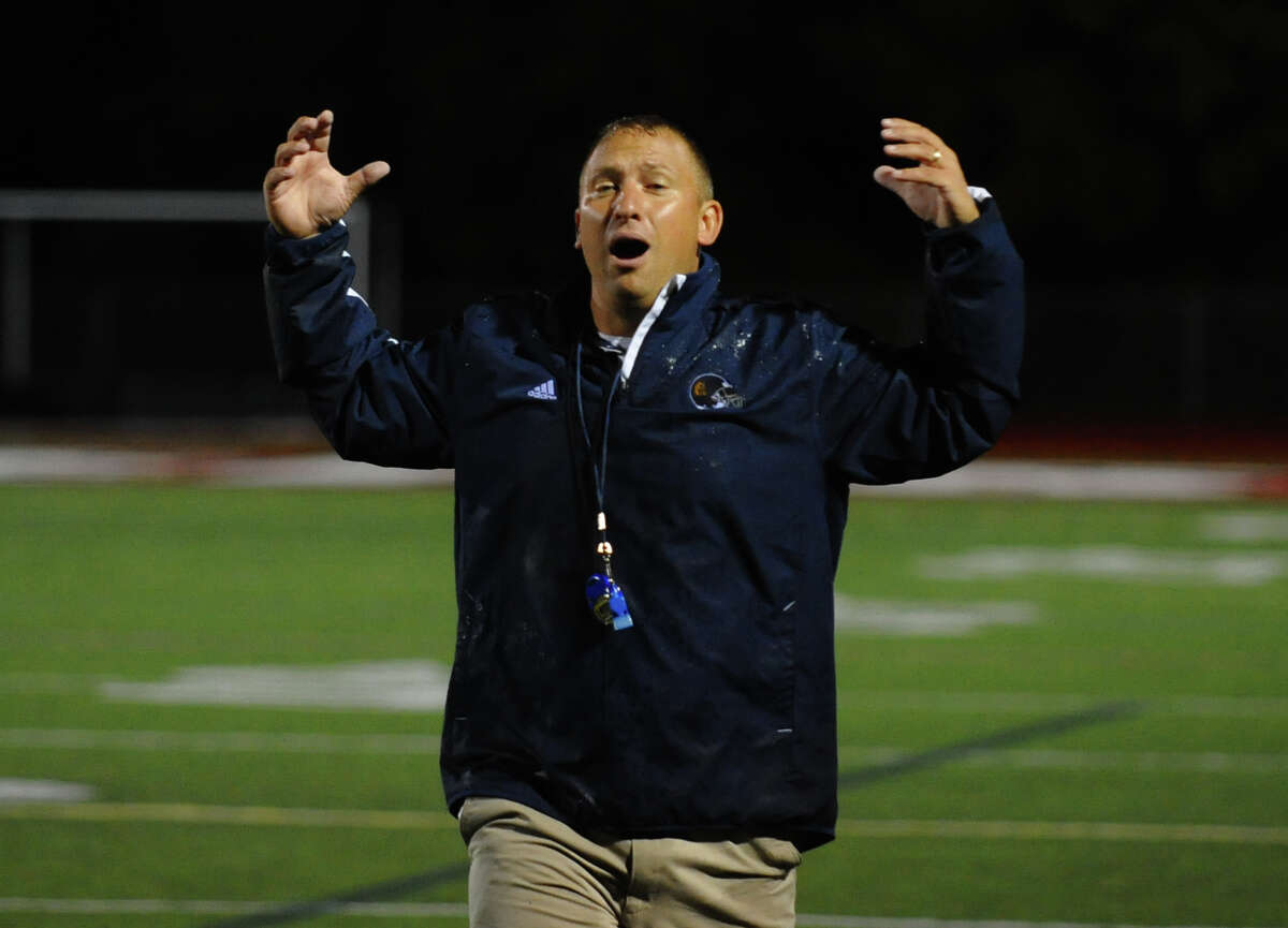 Weston Head Coach Joe Lato, during football action against Pomperaug in Southbury, Conn. on Friday September 28, 2012.